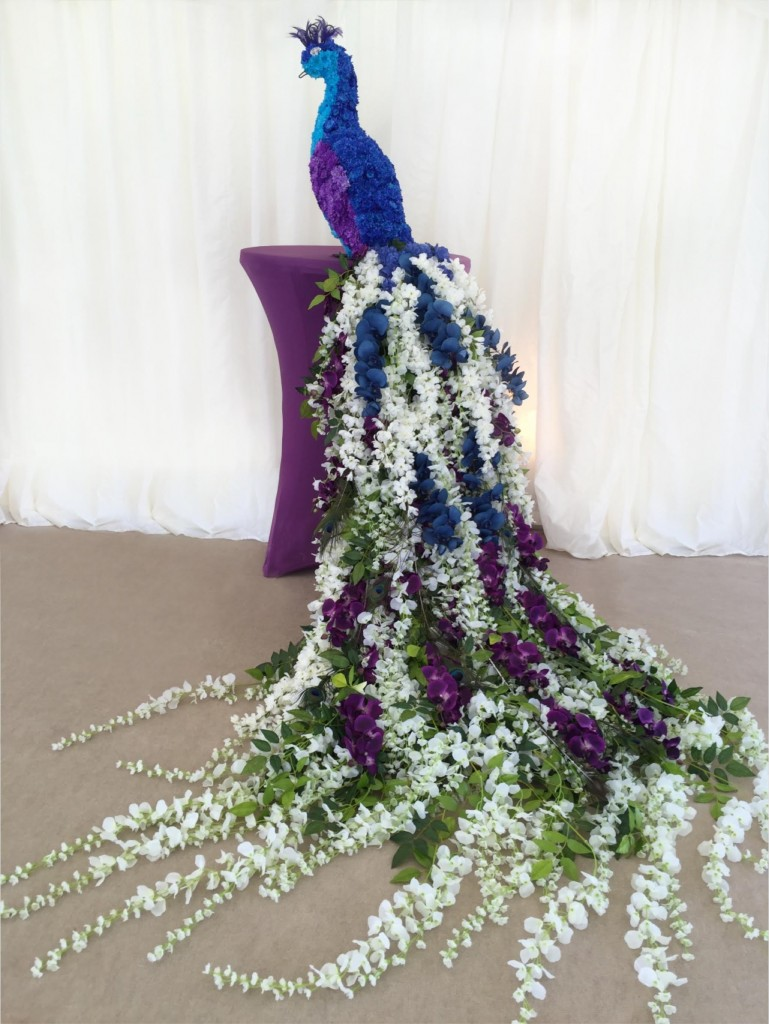 Topiary peacock made with living and artificial flowers.
