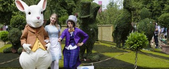 Alice Characters in front of Topiary