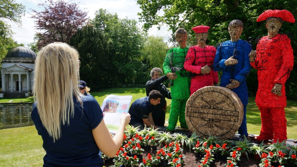 Adding the finishing touches to the Sgt Pepper topiary