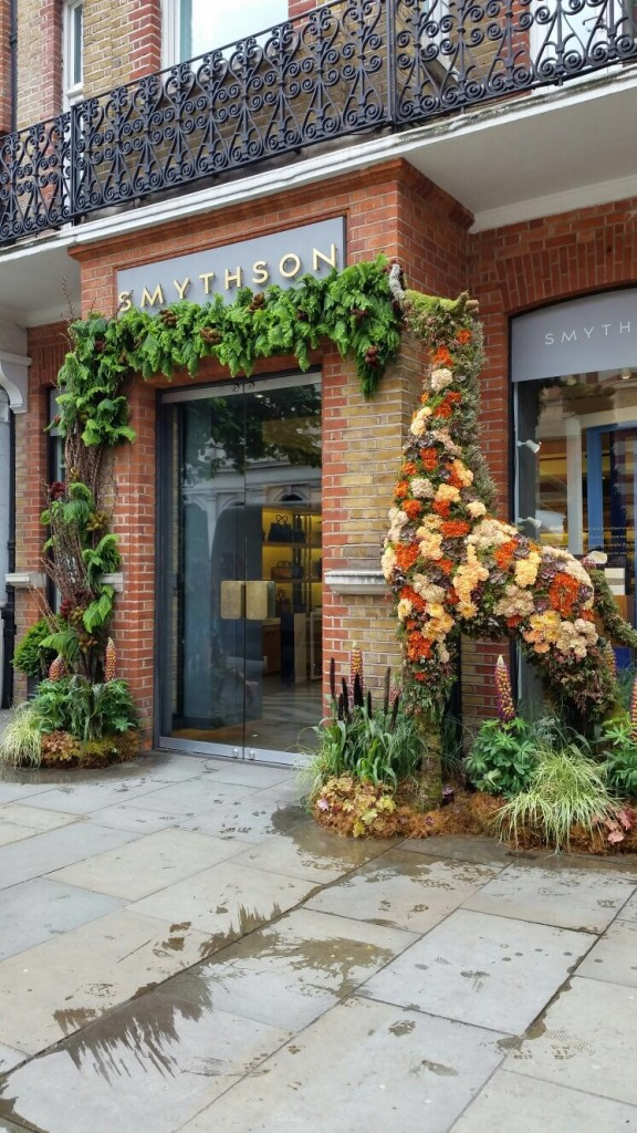 Tall floral topiary giraffe outside Smythson for Chelsea in Bloom