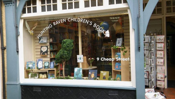 A topiary owl in a bookshop window promoting The Night Gardener