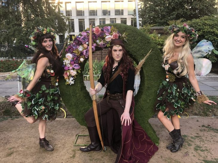 Quantcast logo in moss topiary with 3 cosplay models