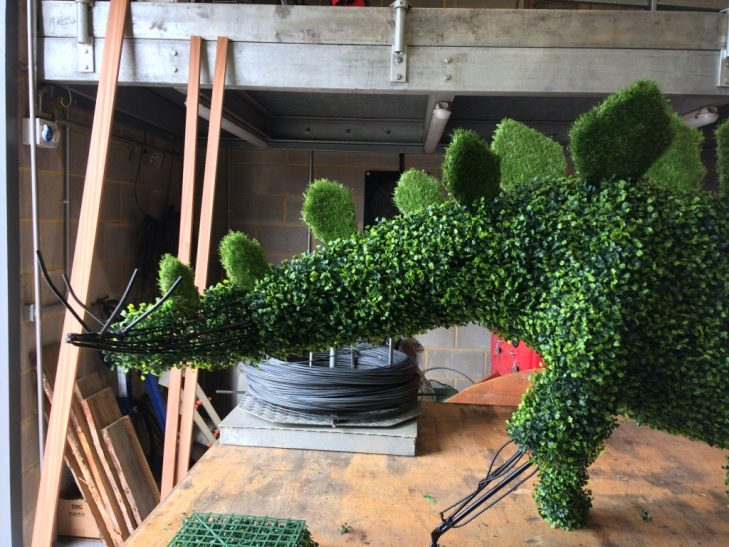The stegosaurus having the finishing touches added to its tail in our topiary workshop
