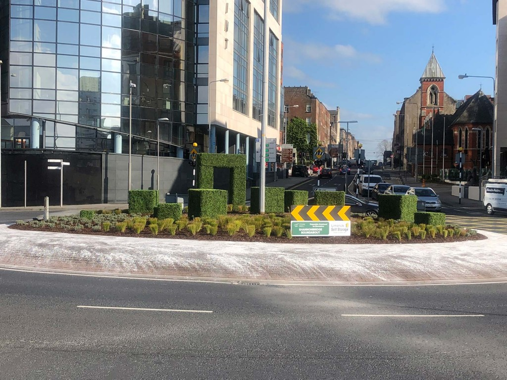 Limerick Roundabout Topiary - An installation by Agrumi for Limerick Self Storage. Picture shows artificial boxwood topiary in the shape of boxes with a doorway
