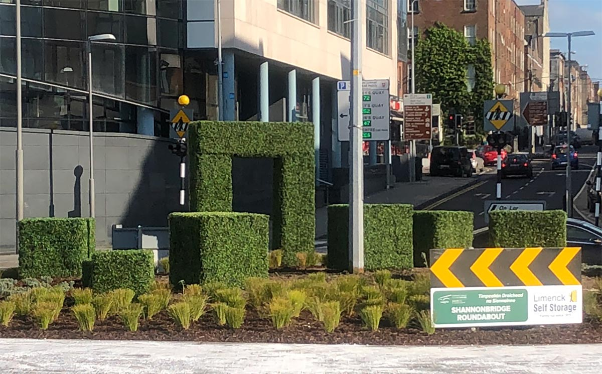 Shannonbridge Roundabout topiary in Limerick. Shows an archway with some topiary boxes